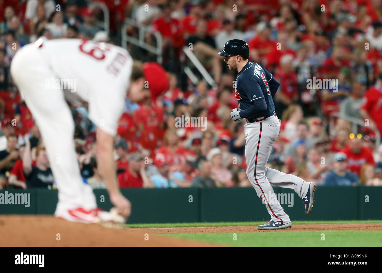 Atlanta Braves Freddie Freeman rounds third base, hitting a solo home run as St. Louis Cardinals starting pitcher Miles Mikolas reaches for the rozin bag in the sixth inning at Busch Stadium in St. Louis on May 24, 2019. Photo by Bill Greenblatt/UPI Stock Photo