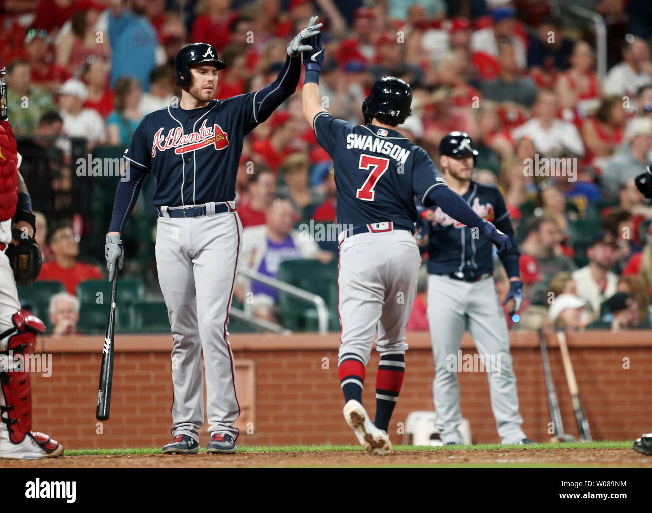 Atlanta Braves Dansby Swanson slaps hands with teammate Freddie Freeman after hitting a two run home run against the St. Louis Cardinals in the eighth inning at Busch Stadium in St. Louis on May 24, 2019. Photo by Bill Greenblatt/UPI Stock Photo