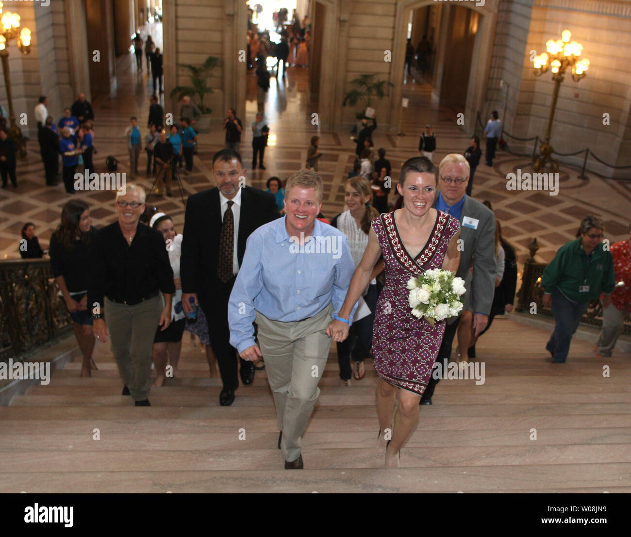 A couple to be married ascends the steps of City Hall in San Francisco on June 17, 2008. City Hall has become a non-stop marriage machine as gay weddings are now legal in California.  (UPI Photo/Terry Schmitt) Stock Photo