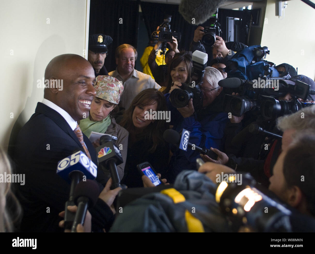 Retired home run king Barry Bonds faces a gaggle of