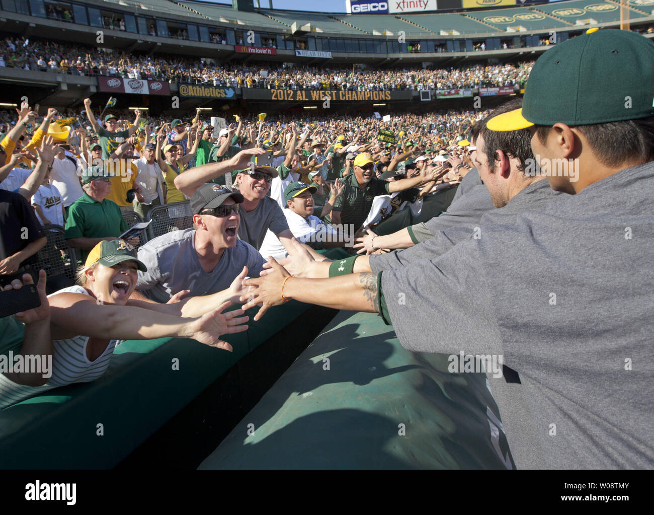 Fans reach to Oakland A's players after sweeping the Texas