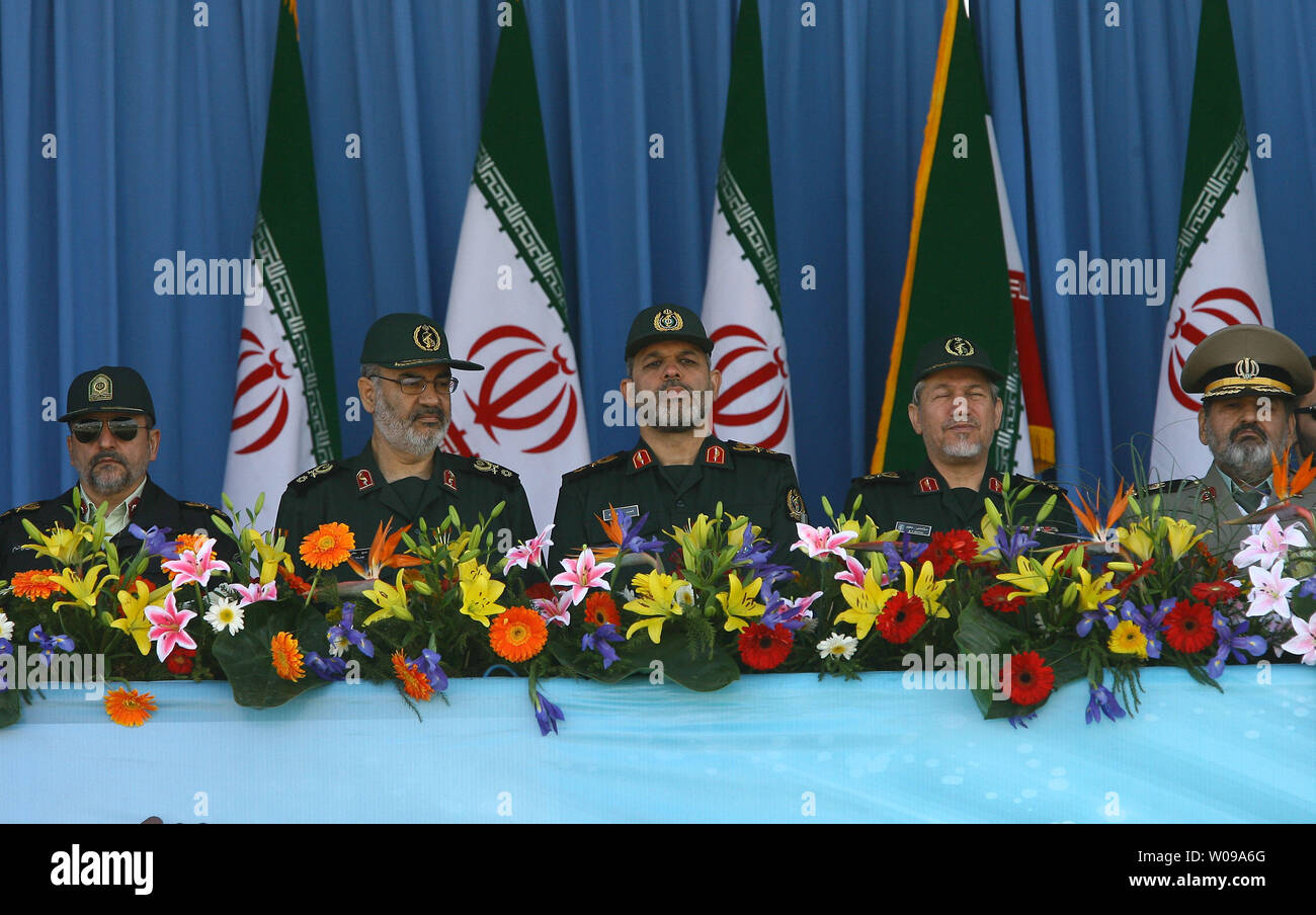 L-R: Iranian Police Chief Ismail Ahmadi-Moghadam, Vice Chairman of the Joint Chiefs of Staff of the IRGC Hossein Salami, Iranian Defense Minister General Ahmad Vahidi, Military Advisor to the Supreme Leader General Rahim Safavi, and Armed Forces Chief of Staff General Hassan Firouzabadi watch the Naitional Army Day military parade in front of the mausoleum of the Iran's late leader  Ayatollah Khomeini in Tehran, Iran on April 18, 2011.   Iranian President Mahmoud Ahmadinejad used the occasion to accuse the United States for sowing discord in the Middle East.    UPI/Maryam Rahmanian - Stock Image