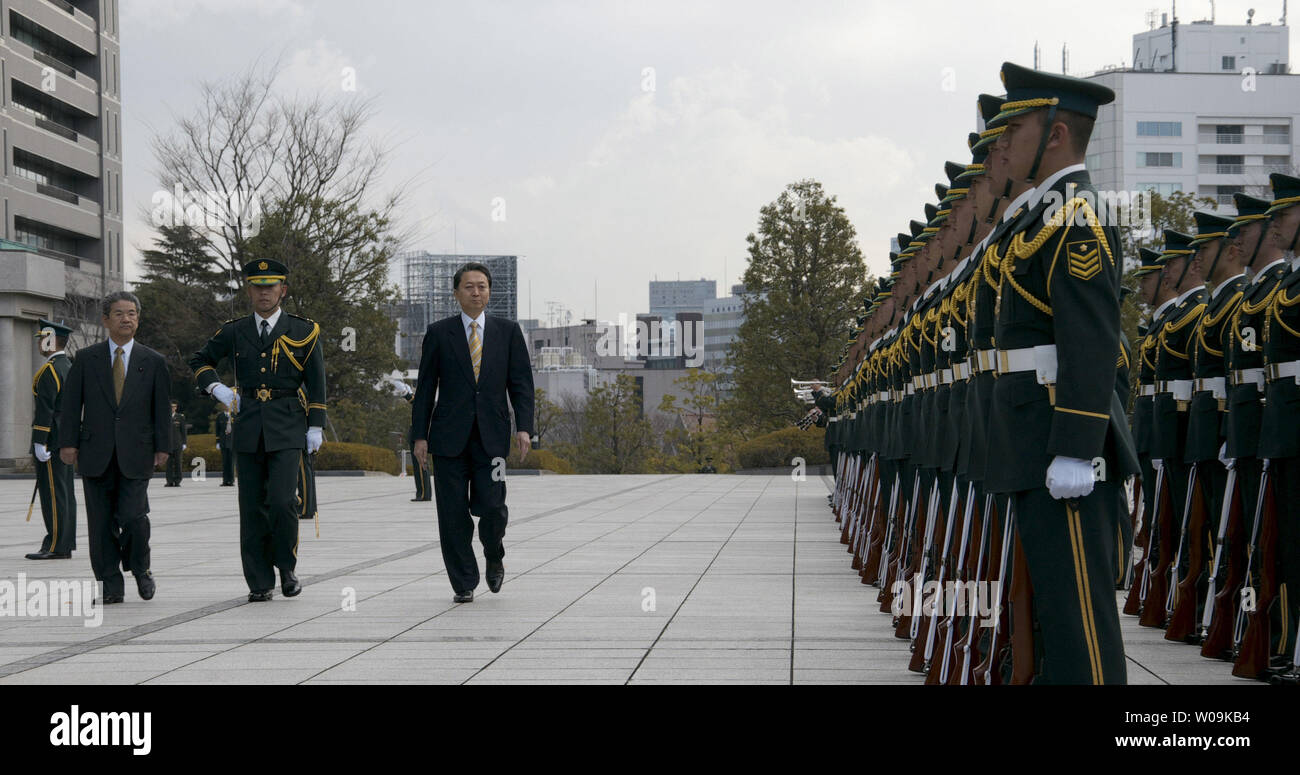 Japan's Prime Minister Yukio Hatoyama(L3) reviews the guard of honor at the Ministry of Defense in Tokyo, Japan, on  January, 13, 2010.     UPI/Keizo Mori - Stock Image