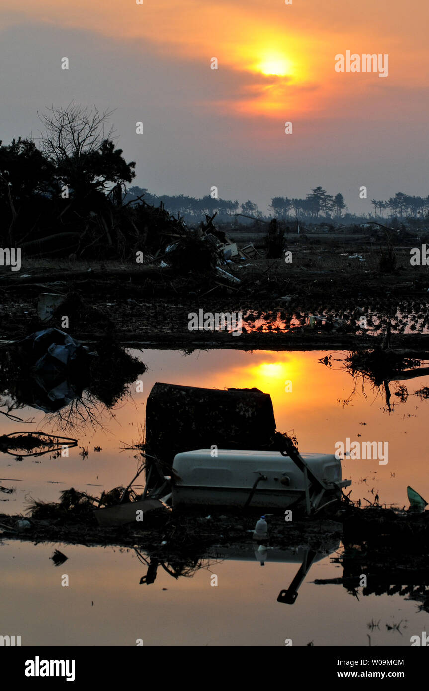 Destruction is seen as the sun rises in Iwanuma, Miyagi prefecture, Japan, on April 15, 2011. A massive earthquake and ensuing tsunami on March 11 destroyed homes, killed thousands and caused a nuclear disaster.    UPI/Keizo Mori - Stock Image