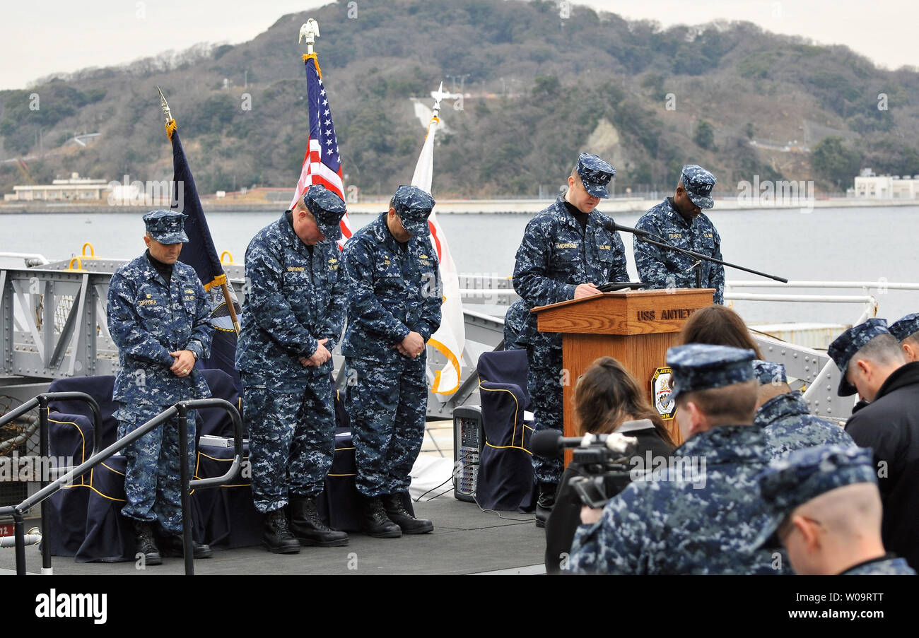 USS Cowpens' Capt. Robert P. Tortora(L), Rear Admiral Mark C. Montgomery(L2), Commander of Battle force Seventh Fleet and USS Antietam's Capt. Thomas C. Disy(L3) pray during USS Cowpens and USS Antietam exchange of Command ceremony aboard the USS Antietam at Yokosuka U.S. Naval Base in Kanagawa-prefecture, Japan on February 5, 2013.     UPI/Keizo Mori - Stock Image
