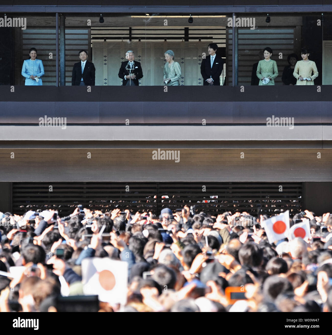 Japan's Emperor Akihito(L3) speaks to well-wishers from a balcony during a new year greeting at the East Plaza, Imperial Palace in Tokyo, Japan, on January 2, 2014.      UPI/Keizo Mori - Stock Image
