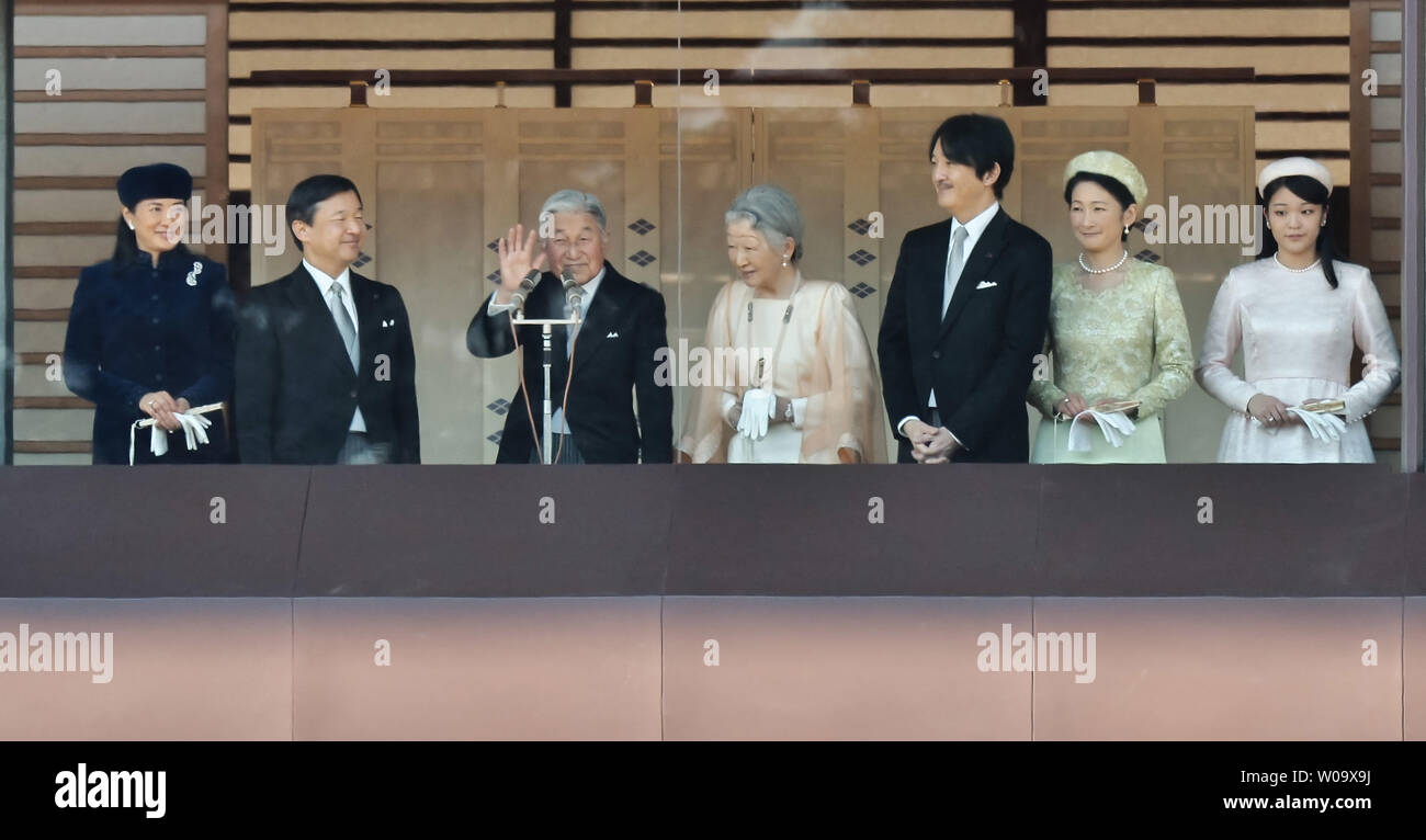 Japan's Emperor Akihito(L3) waves to well-wishers during his Majesty's 81st birthday greeting at the East Plaza, Imperial Palace in Tokyo, Japan, on December 23, 2014.     UPI/Keizo Mori - Stock Image