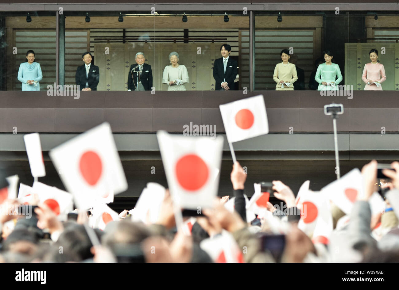 Japan's Emperor Akihito(L3) speaks to well-wishers during a New Year greeting at the East Plaza, Imperial Palace in Tokyo, Japan, on January 2, 2015.     UPI/Keizo Mori - Stock Image