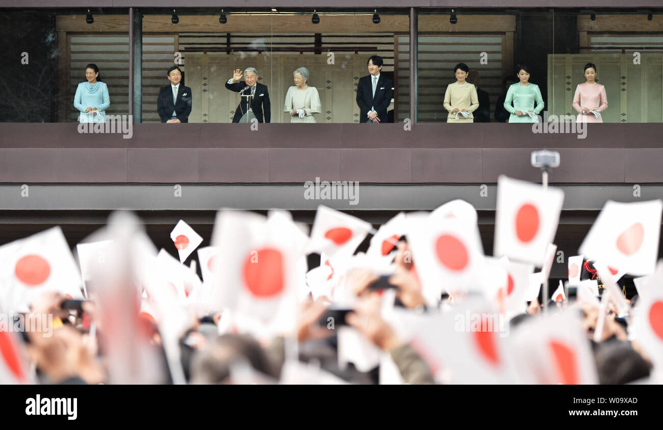 Japan's Emperor Akihito(L3) waves to well-wishers during a New Year greeting at the East Plaza, Imperial Palace in Tokyo, Japan, on January 2, 2015.     UPI/Keizo Mori - Stock Image