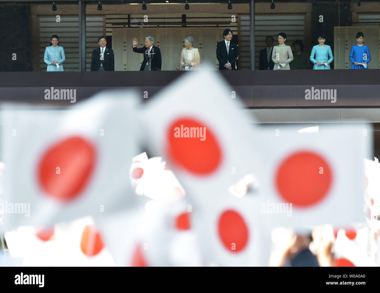 Japan's Emperor Akihito(L3) waves to well-wishers during a New Year greeting at the East Plaza, Imperial Palace in Tokyo, Japan, on January 2, 2016.     Photo by Keizo Mori/UPI - Stock Image