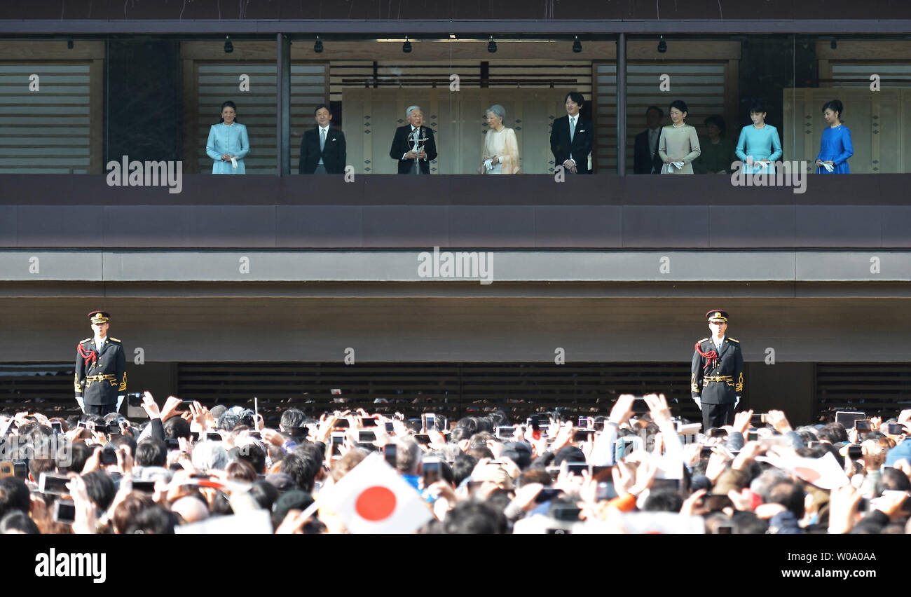 Japan's Emperor Akihito(L3) speaks to well-wishers during a New Year greeting at the East Plaza, Imperial Palace in Tokyo, Japan, on January 2, 2016.     Photo by Keizo Mori/UPI - Stock Image