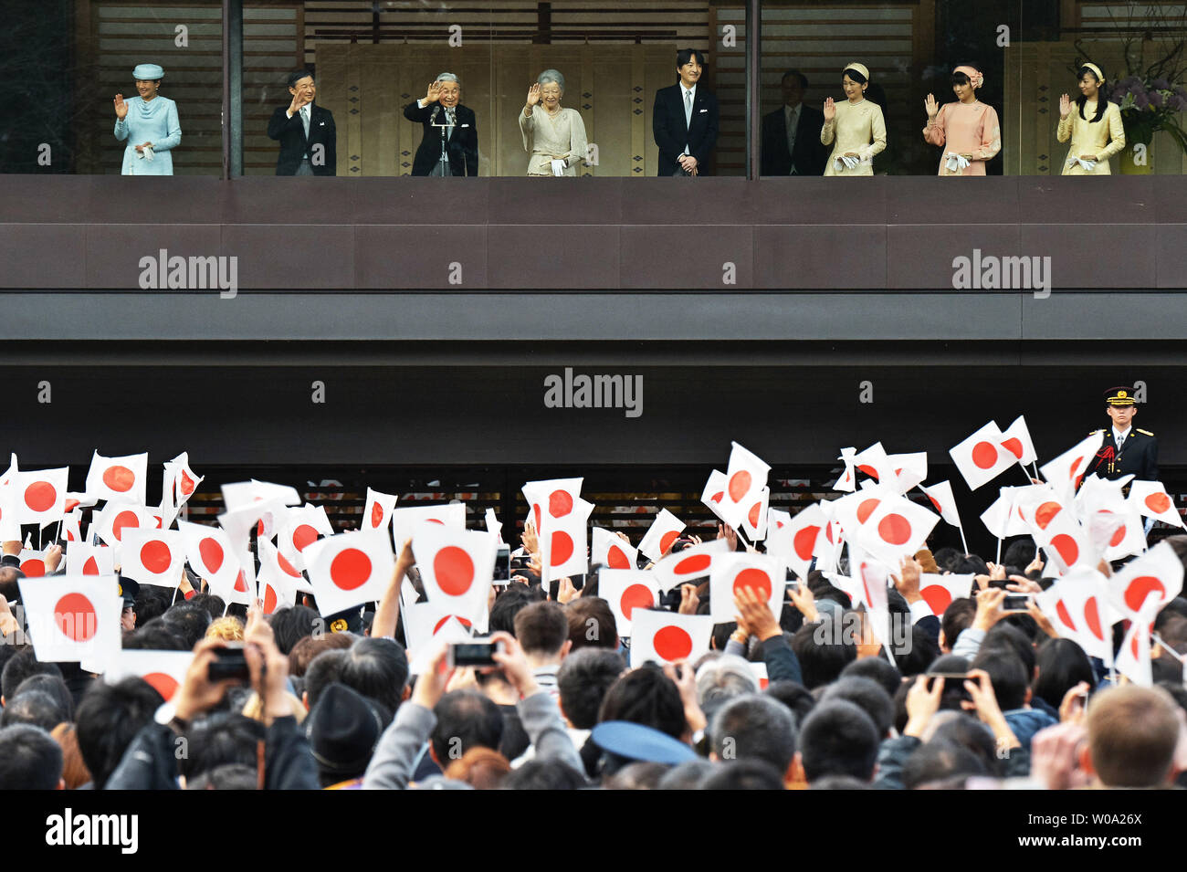 Japan's Emperor Akihito(L3) waves to well-wishers with Empress Michiko(L4), Crown prince Naruhito(L2), Crown princess Masako(L), Prince Akishino (R4), his wife Princess Kiko(R3), Princess  Mako(R2) and Princess Kako(R) during his Majesty's 83rd birthday greeting at the East Plaza, Imperial Palace in Tokyo, Japan, on December 23, 2016.     Photo by Keizo Mori/UPI - Stock Image