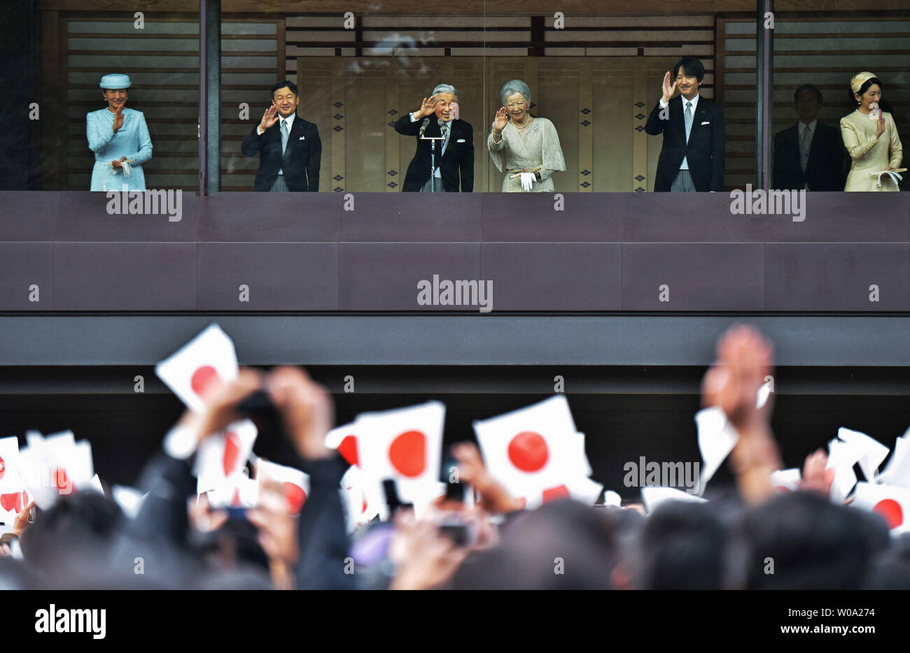 Japan's Emperor Akihito(L3) waves to well-wishers with Empress Michiko(R3), Crown prince Naruhito(L2), Crown princess Masako(L), Prince Akishino (R2), and his wife Princess Kiko(R) during his Majesty's 83rd birthday greeting at the East Plaza, Imperial Palace in Tokyo, Japan, on December 23, 2016.     Photo by Keizo Mori/UPI - Stock Image