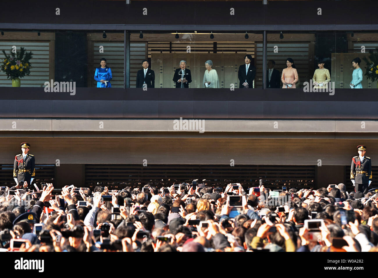 Japan's Emperor Akihito(L3) speaks to well-wishers during a new year greeting at the East Plaza, Imperial Palace in Tokyo, Japan, on January 2, 2017.     Photo by Keizo Mori/UPI - Stock Image