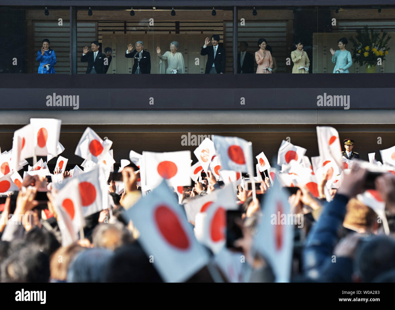 Japan's Emperor Akihito(L3) waves to well-wishers with Empress Michiko(L4), Crown prince Naruhito(L2), Crown princess Masako(L), Prince Akishino (R4), his wife Princess Kiko(R3), Princess  Mako(R2) and Princess Kako(R) during a new year greeting at the East Plaza, Imperial Palace in Tokyo, Japan, on January 2, 2017.     Photo by Keizo Mori/UPI - Stock Image