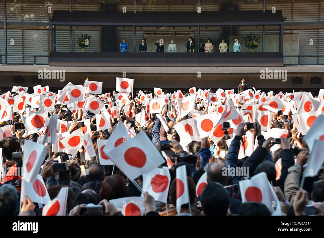Japan's Emperor Akihito(L3) waves to well-wishers during a new year greeting at the East Plaza, Imperial Palace in Tokyo, Japan, on January 2, 2017.     Photo by Keizo Mori/UPI - Stock Image