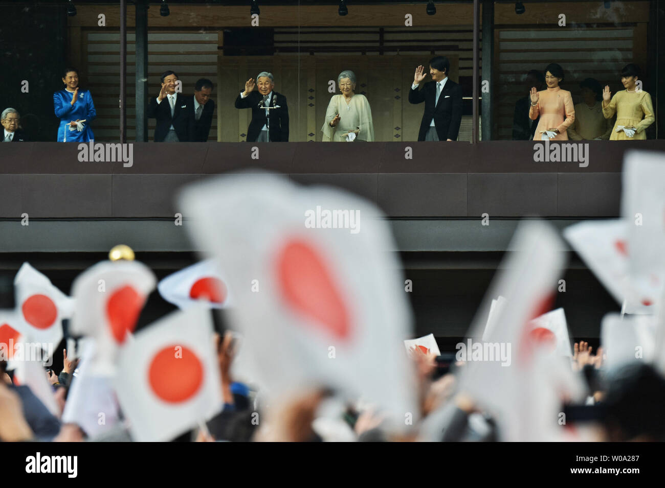 Japan's Emperor Akihito(L3) waves to well-wishers with Prince Hitachi(L), Empress Michiko(L5), Crown prince Naruhito(L3), Crown princess Masako(L2), Prince Akishino (R3), his wife Princess Kiko(R2) and Princess  Mako(R) during a new year greeting at the East Plaza, Imperial Palace in Tokyo, Japan, on January 2, 2017.     Photo by Keizo Mori/UPI - Stock Image