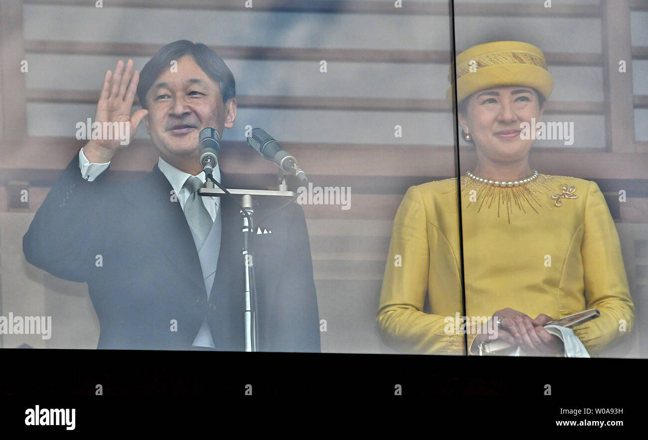 Japan's new Emperor Naruhito and Empress Masako wave to well