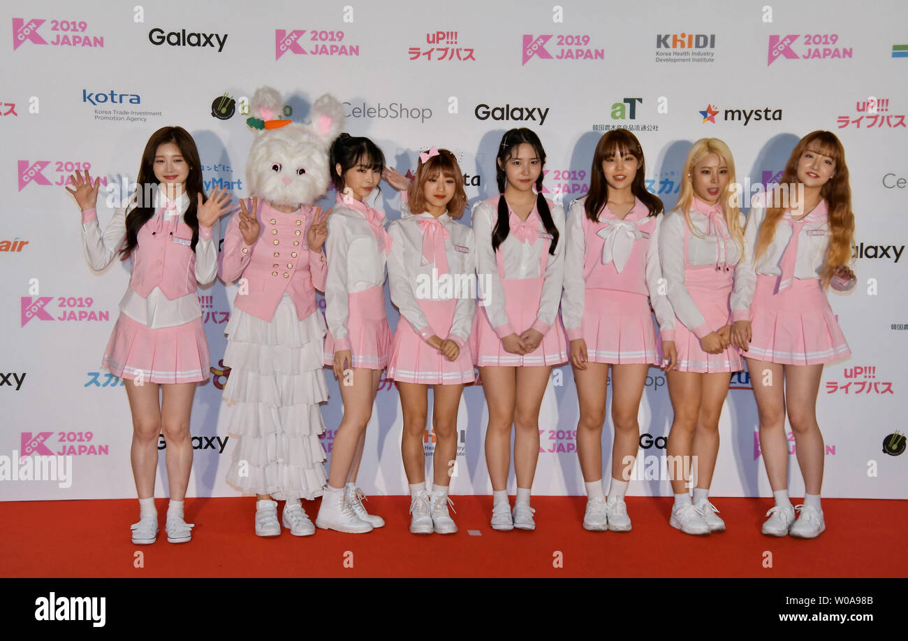 Members of South Korean girl group Pink Fantasy pose for