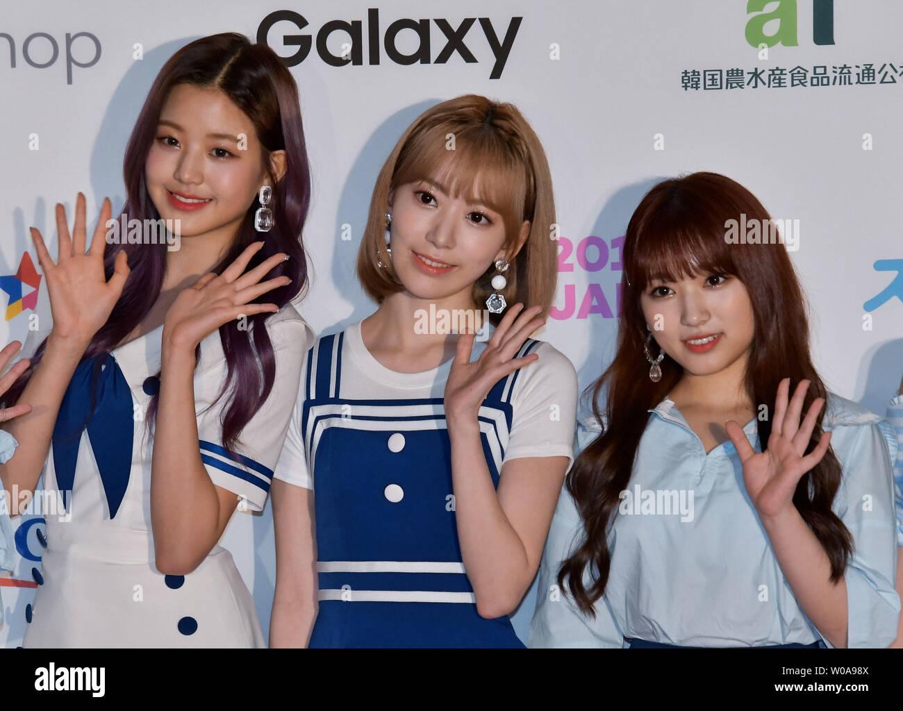 Members of South Korean and Japanese girl group IZ*ONE pose