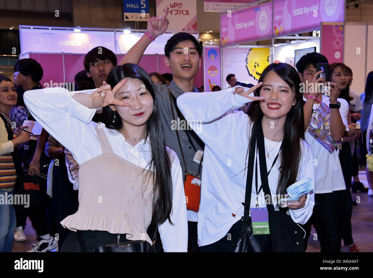 Visitors pose for photographer during the