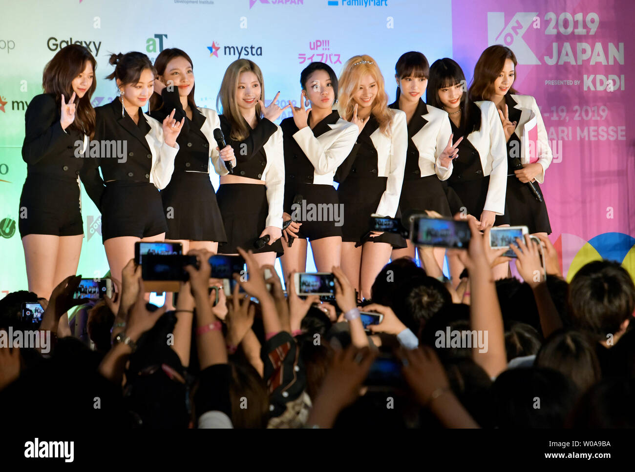 Members of multinational girl group TWICE attend the redcarpet