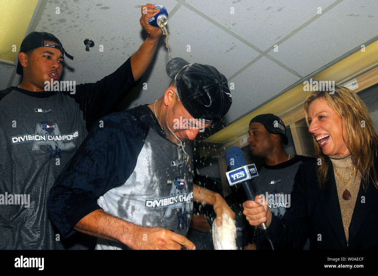 New York Yankees' Derek Jeter gets a dousing as he is being