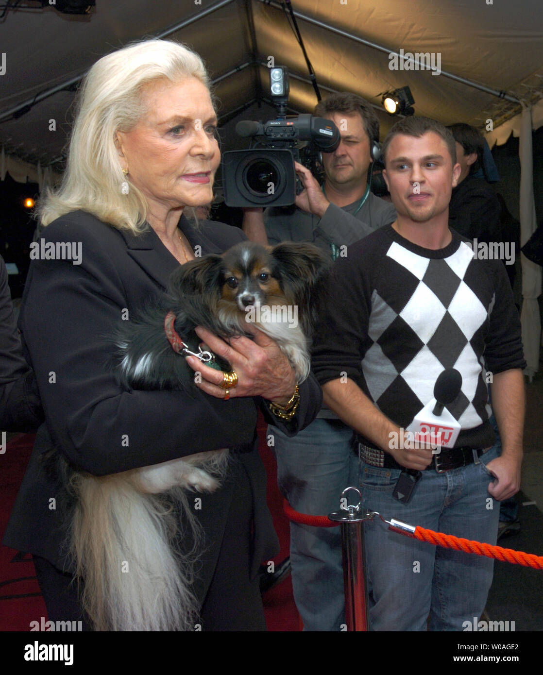 "Screen legend Lauren Bacall arrives with her dog Sophie for the Toronto International Film Festival gala premiere of ""The Walker"" at Roy Thomson Hall in Toronto, Canada on September 13, 2007. (UPI Photo/Christine Chew) Stock Photo"