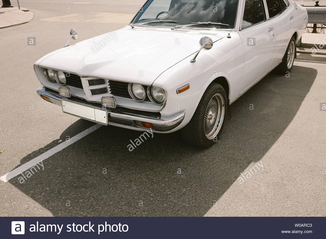 White vintage retro car on a parking. Stock Photo