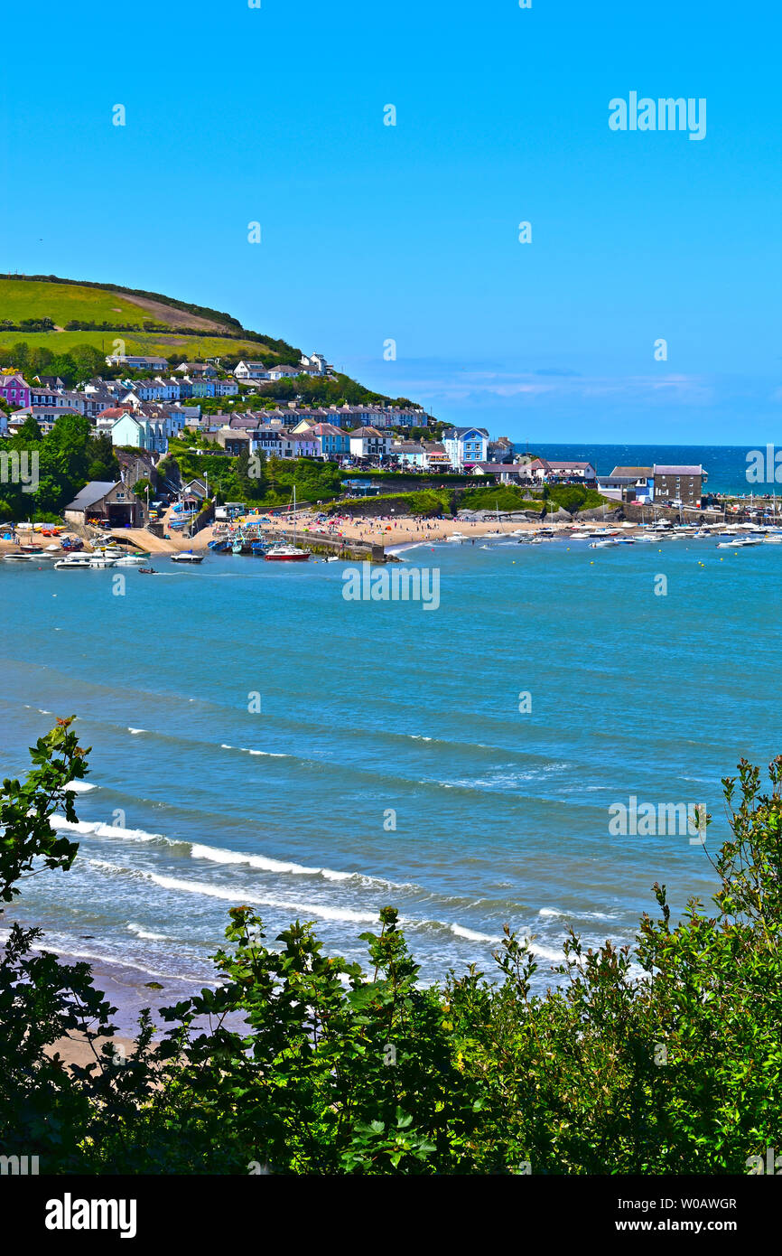 A stunning view of the pretty little fishing port of Newquay in Wales. A seaside resort with lovely sandy beach & good for fishing & dolphin watching. - Stock Image