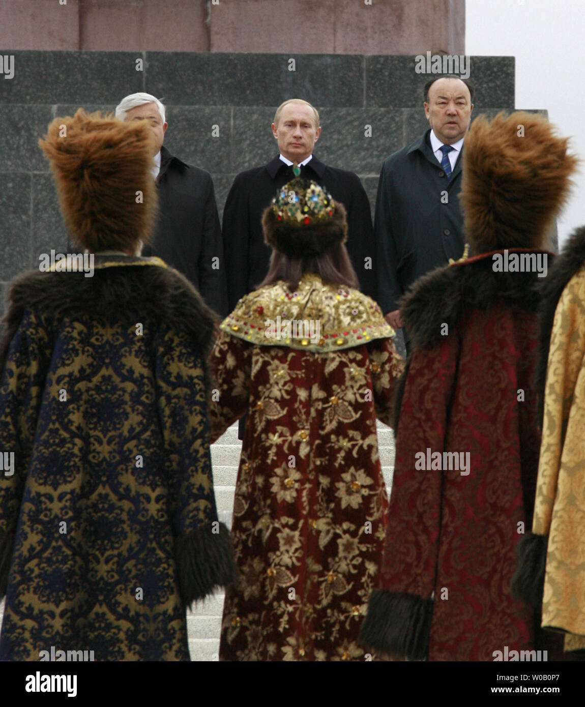 Russian President Vladimir Putin C Is Greeted By Women In Traditional Wool Dresses In City Of Ufa Upon His Arrival With The One Day Visit To The Russian Province Of Bashkortostan In