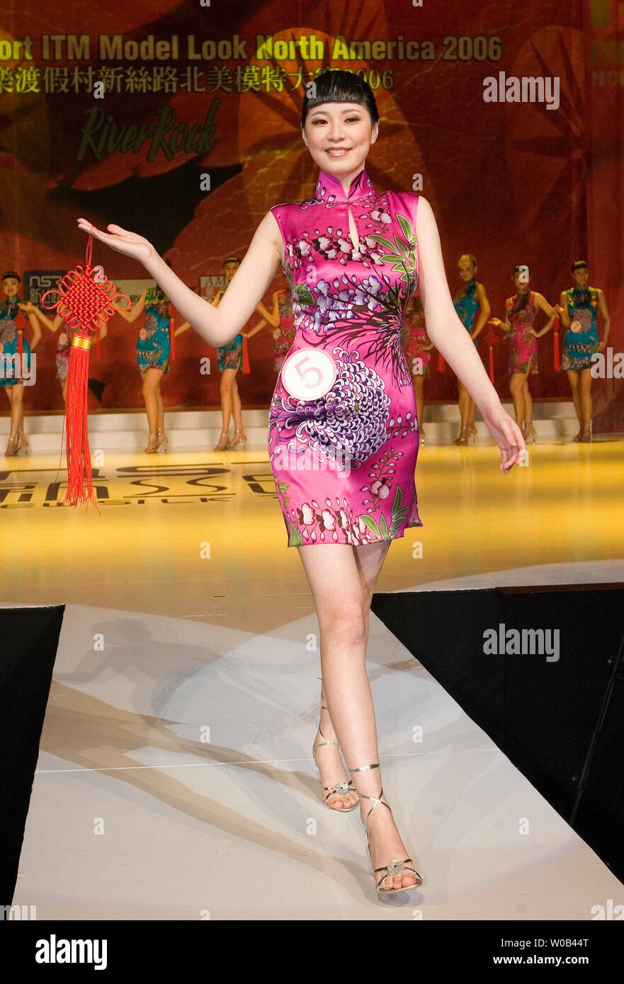 Michelle Jiang walks the runway before a full house at River