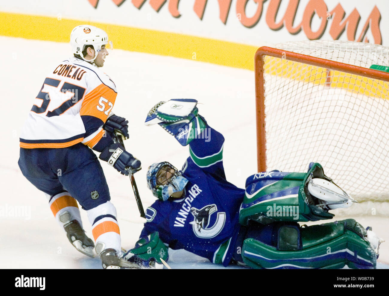 Vancouver Canucks Goalie Roberto Luongo Makes A Glove Save Against