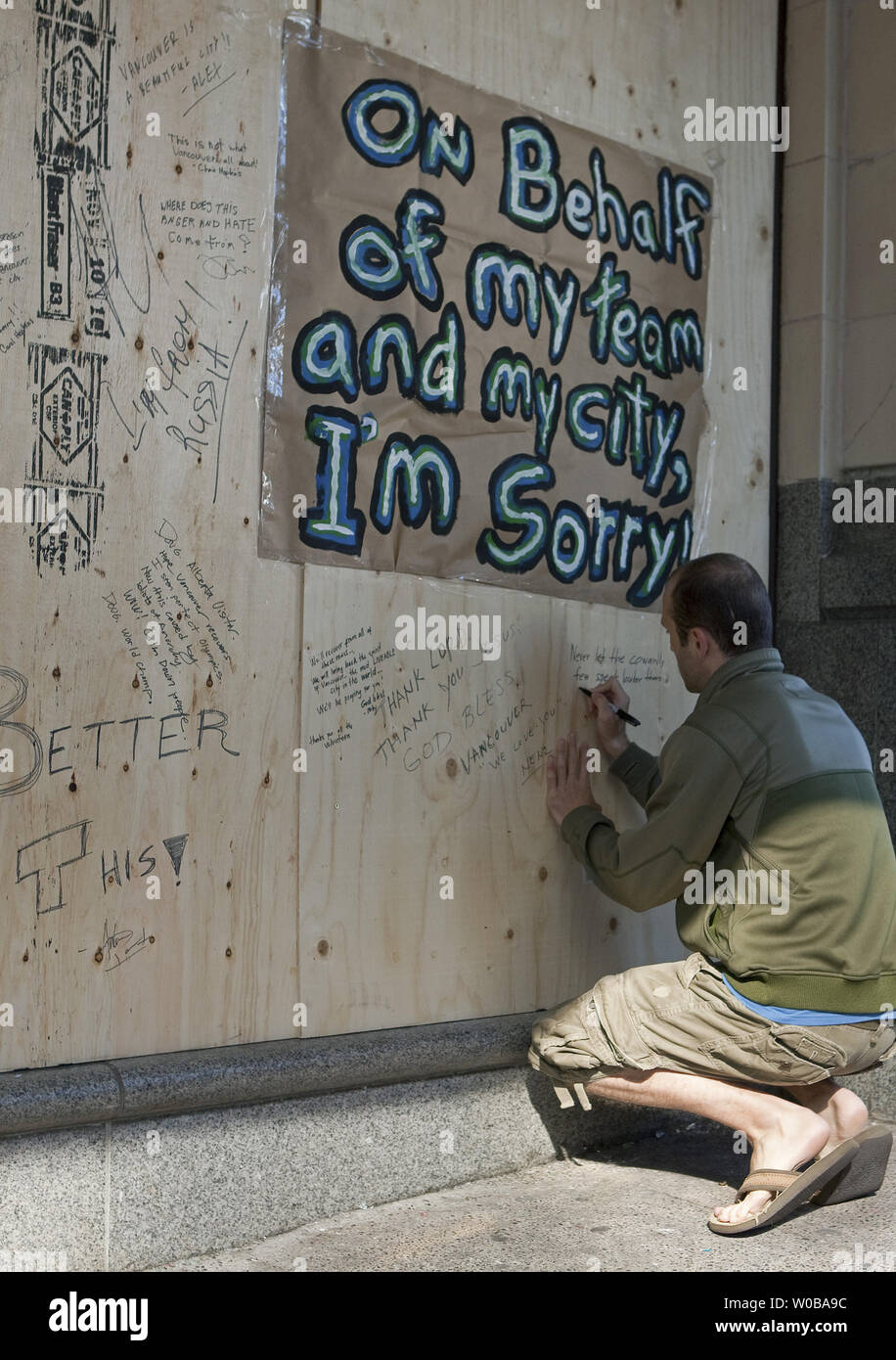 the latest 12718 661c2 People passing by or going to work stop to write notes of ...