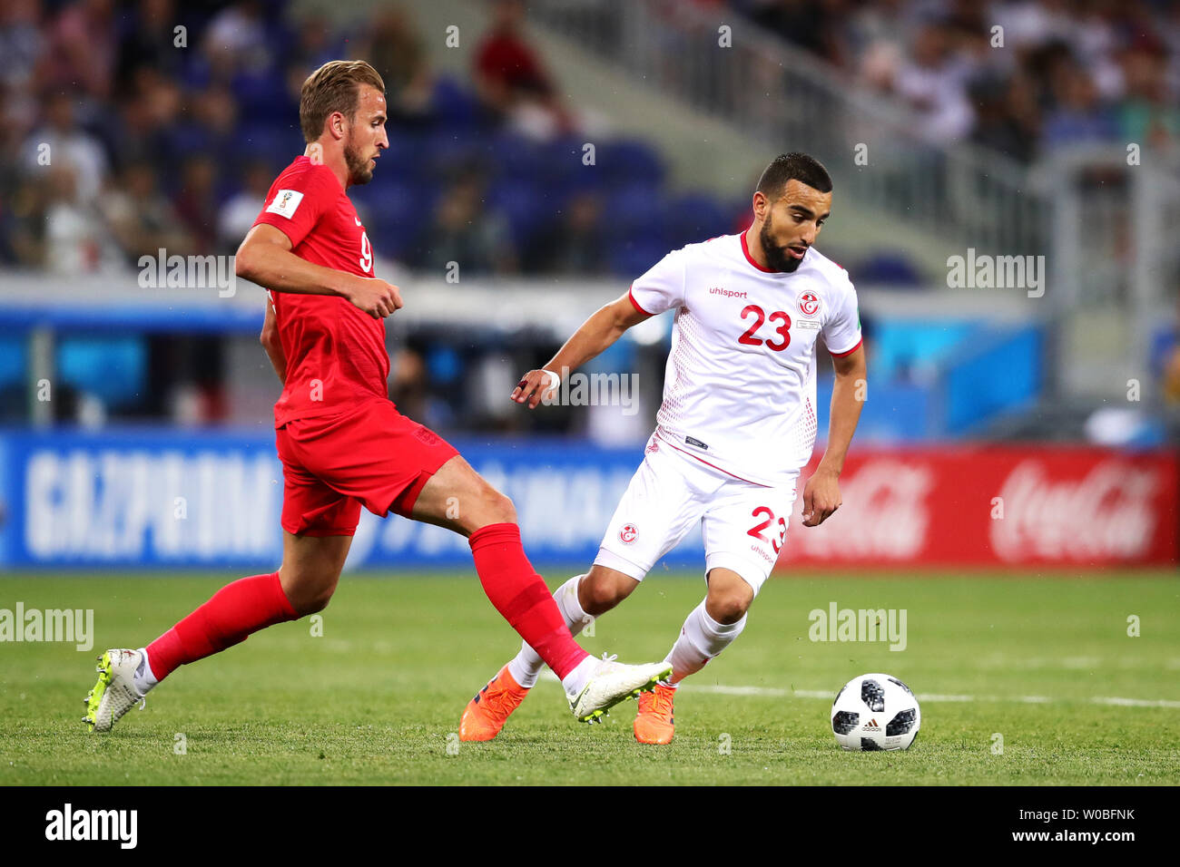 Naim Sliti (R) of Tunisia in action with Harry Kane of