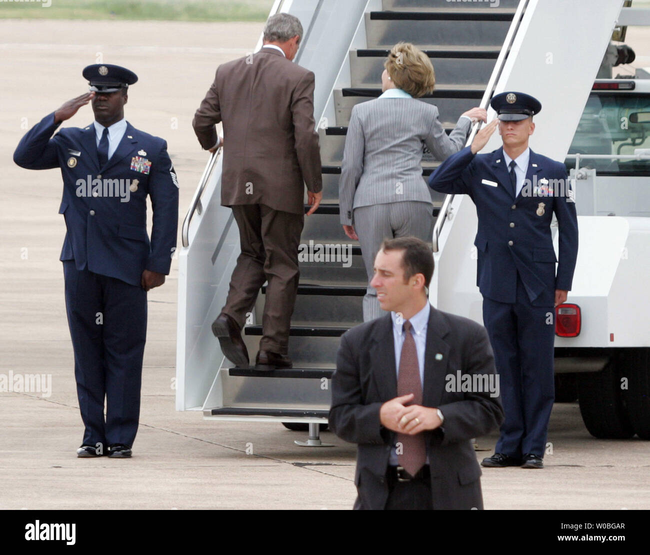 U.S. President George W. Bush and First Lady Laura Bush embark on Air Force One at the airport in Waco, Texas, en route to Arizona and California to discuss Medicare on Aug. 29, 2005.   (UPI Photo/Ruon Russek II) Stock Photo