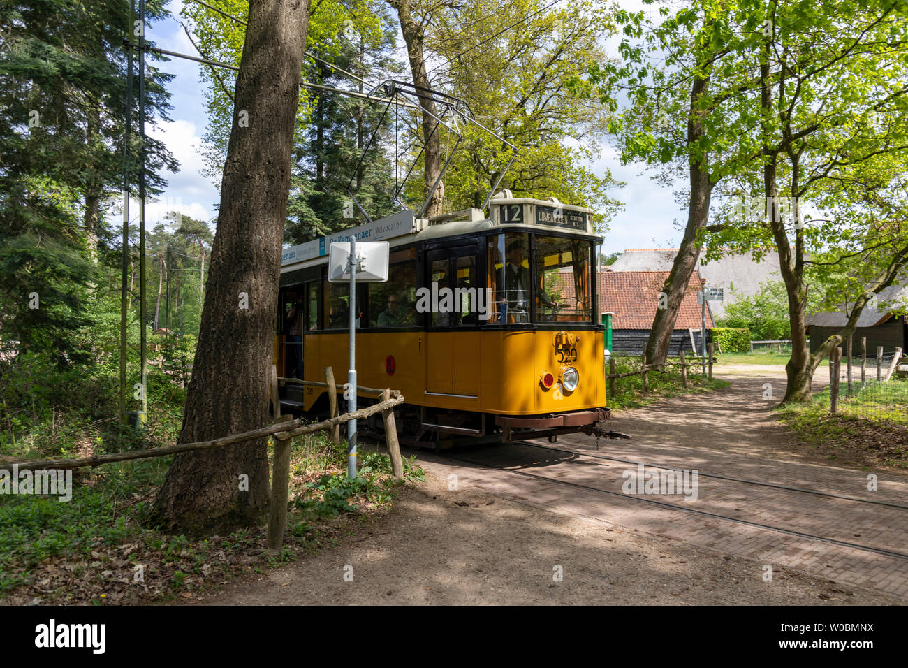 A vintage Tram running through Holland's open air museum.  A lovely day out viewing the culture, architecture and livelyhoods of old Netherlands - Stock Image