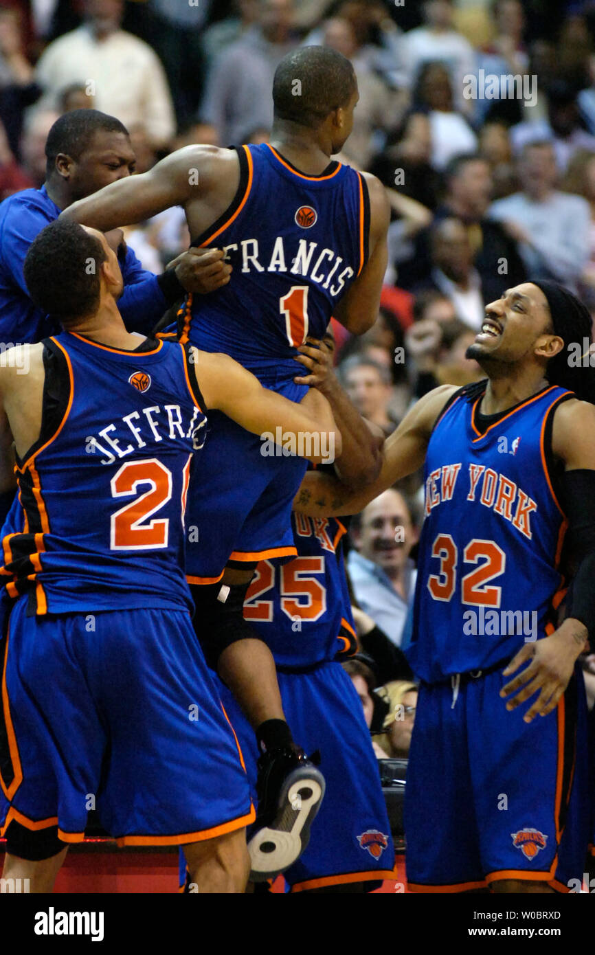 separation shoes a8d4b c9429 New York Knicks guard Steve Francis (1) is congratulated by ...