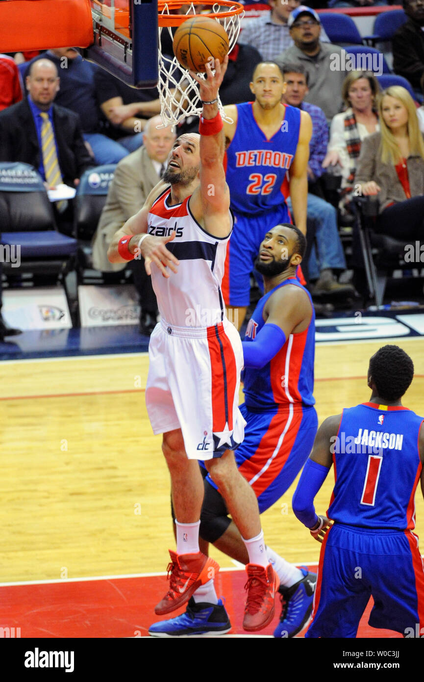 Washington Wizards center Marcin Gortat (4) scores against Detroit Pistons center Andre Drummond (0) in the first half at the Verizon Center in Washington, D.C. on February 28, 2015.   Photo by Mark Goldman/UPI Stock Photo