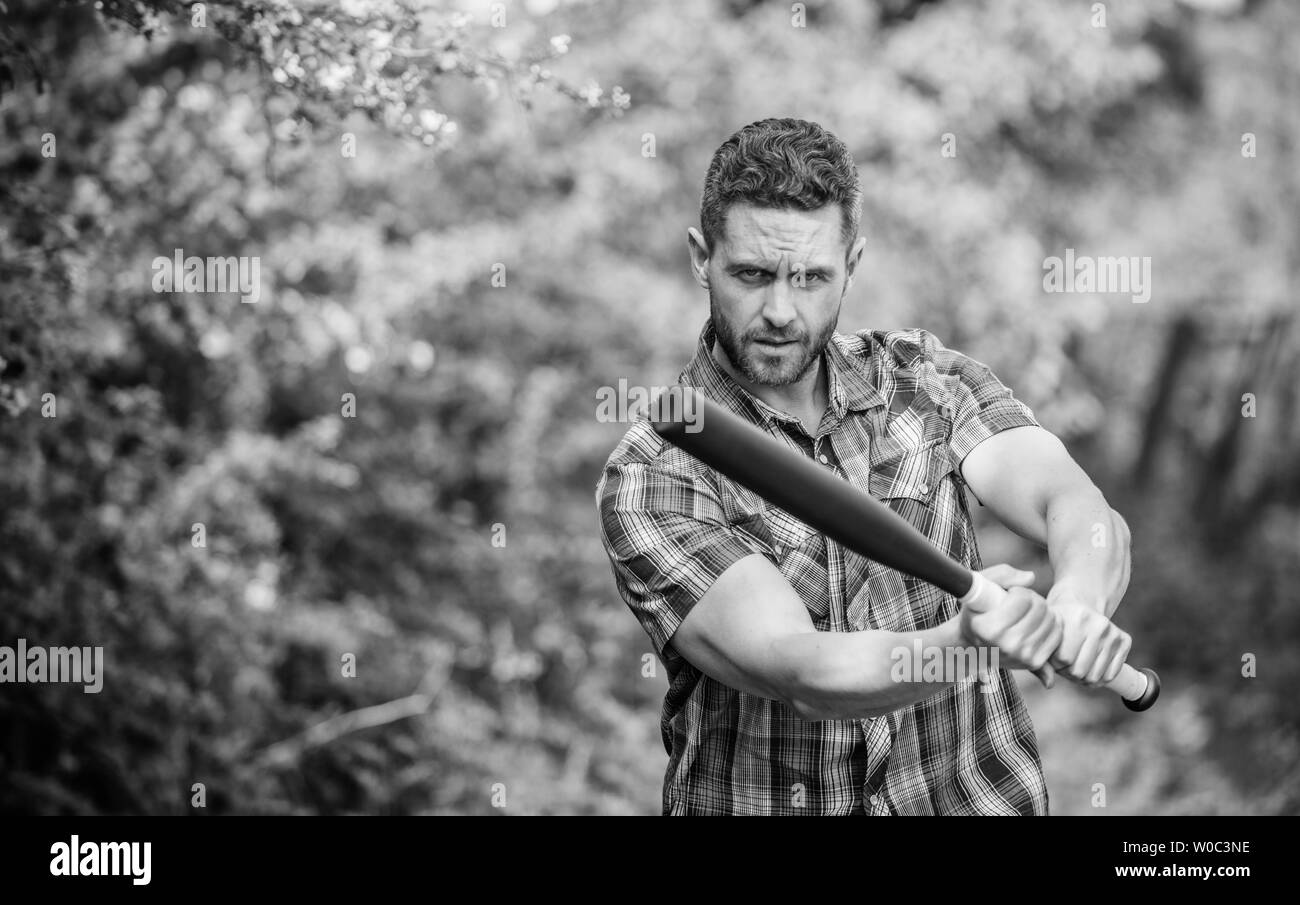 i am a criminal. outdoor sport activity. Hooligan man hits the bat. Bandit gang and conflict. aggression and anger. full of energy. unshaven muscular man fighting. man with baseball bat. Be strong. - Stock Image