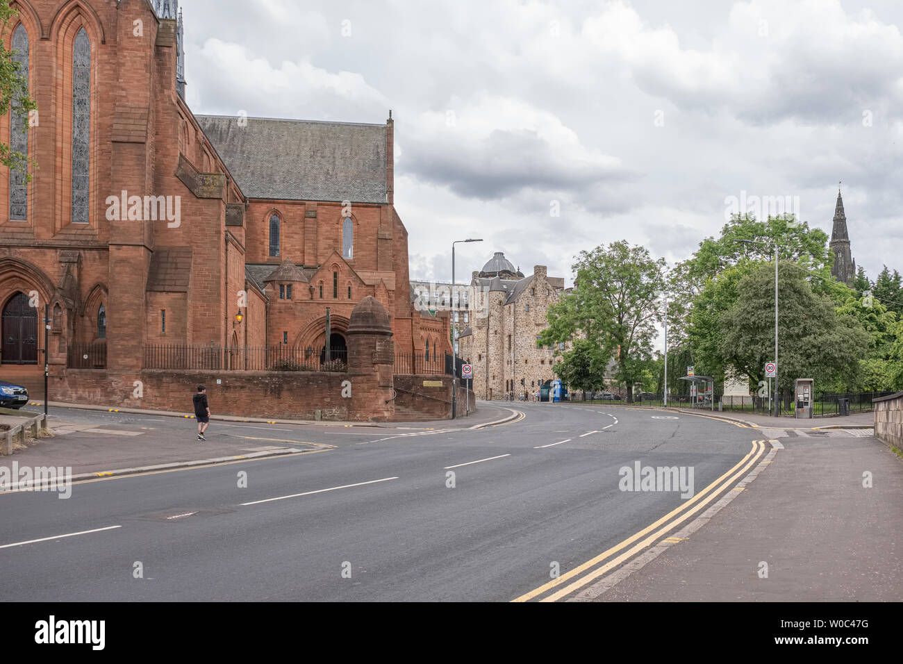 Looking over to the Barony Parish Church in Castle Street at intersection with Rottenrow and Macleod Street Now University of Strathclyde ceremonial h Stock Photo