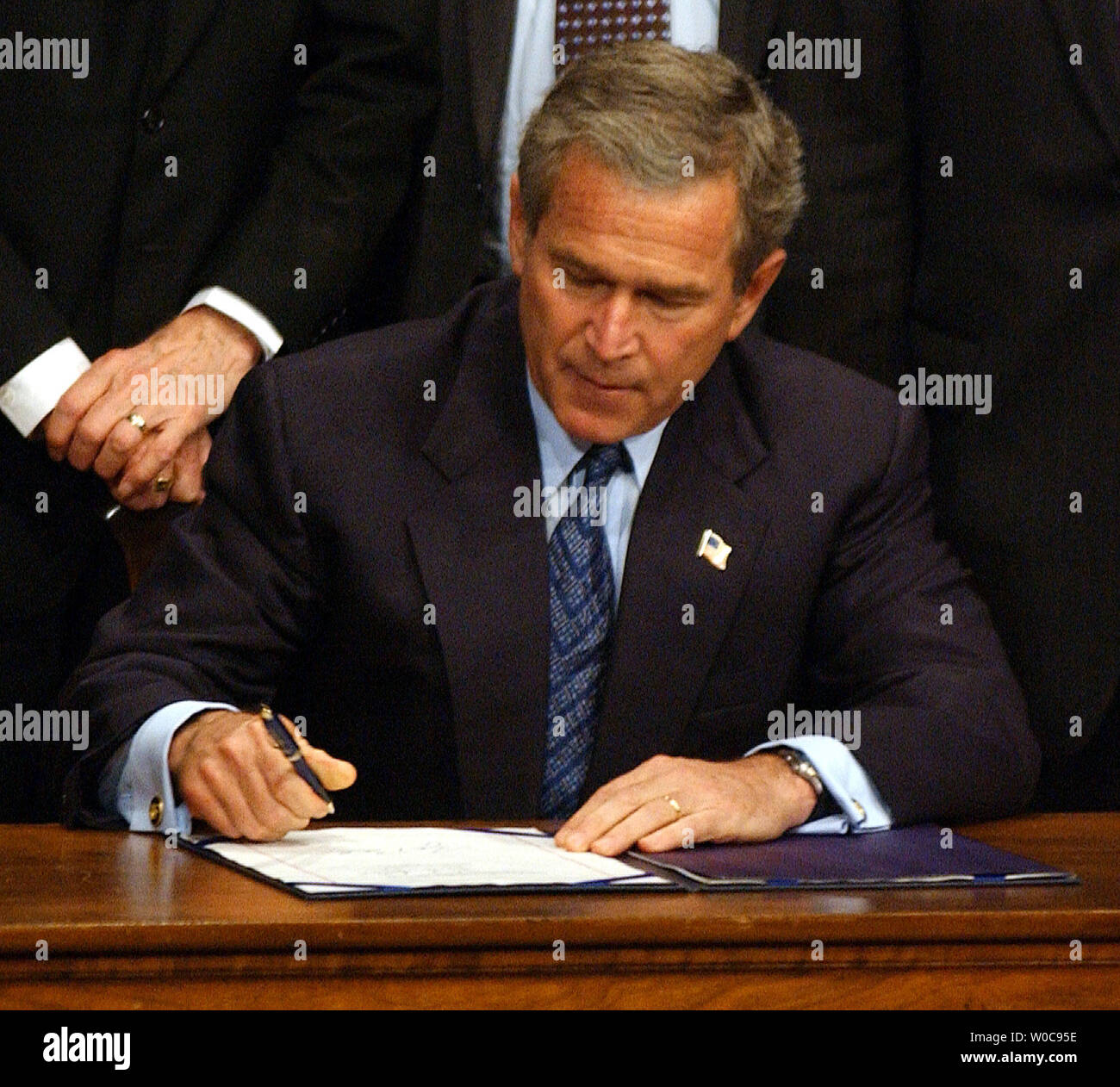 President George W. Bush signs a bill banning partial birth abortions on November 5, 2003, in Washington. In remarks the President said his administration would vigorously defend the legality of the bill.    (UPI/Roger L. Wollenberg) Stock Photo