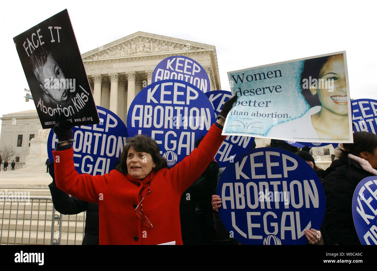 Elaine Hanger, of Chesterfield, Va., tries to block pro-choice signs with her own anti-abortion signs during a protest march on January 22, 2004, in Washington. This is the 31st annual march held on the anniversary of the Supreme Court decision Roe vs. Wade which legalized abortions across the U.S.   (UPI Photo/Roger L. Wollenberg) Stock Photo
