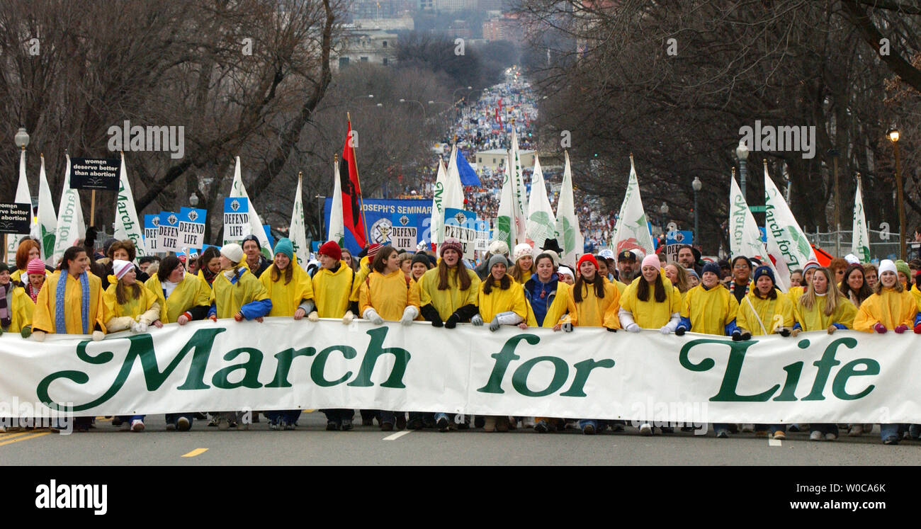 Tens of thousands of protestors march against abortion on January 22, 2004, in Washington. This is the 31st annual march held on the anniversary of the Supreme Court decision Roe vs. Wade which legalized abortions across the U.S.   (UPI Photo/Roger L. Wollenberg) Stock Photo