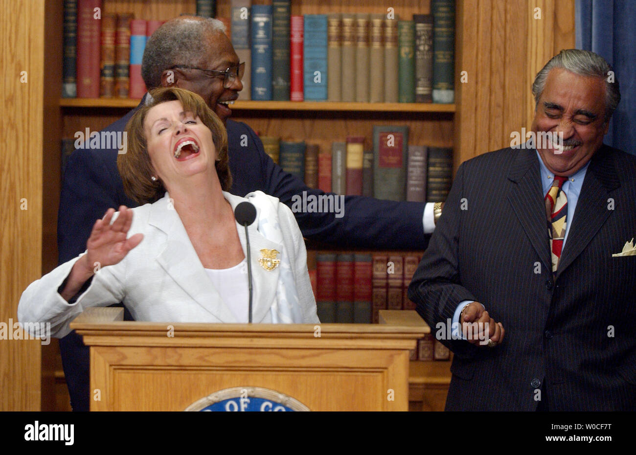 Democratic Reps. Nancy Pelosi, Calif., James Clyburn, N.C., and Charles  Rangel, N.Y., left to right, laugh hysterically after Rangel joked about  the possible price of Depends during a news conference to warn