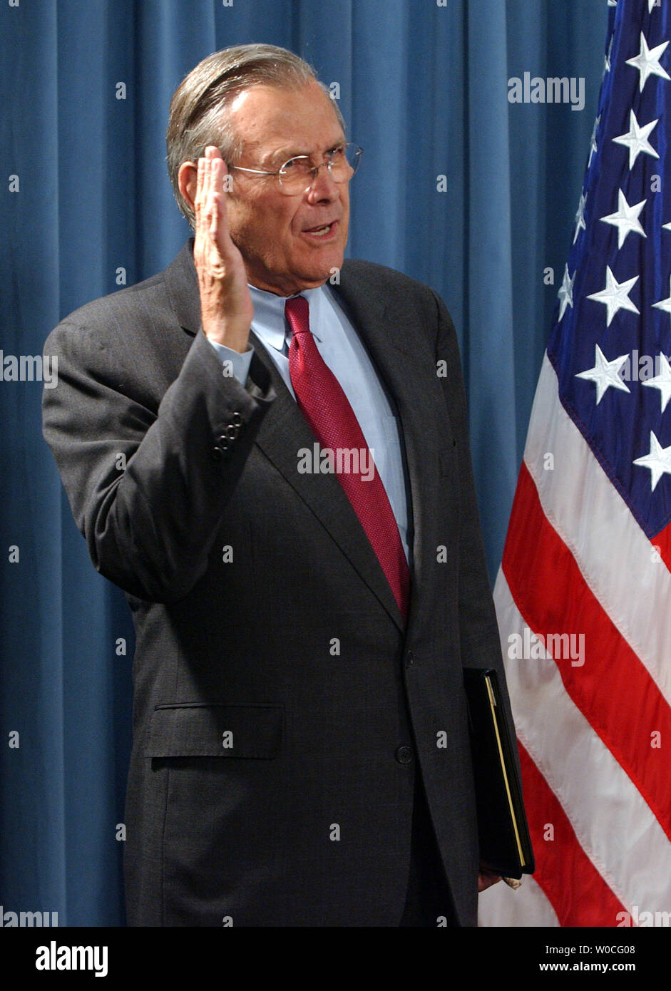 Defense Secretary Donald Rumsfeld speaks to the media about a US lead operation to take control of the Iraqi city of Fallujah from insurgents during a news conference at the Pentagon in Arlington, Va., on Nov. 8, 2004.    (UPI Photo/Roger L. Wollenberg) Stock Photo