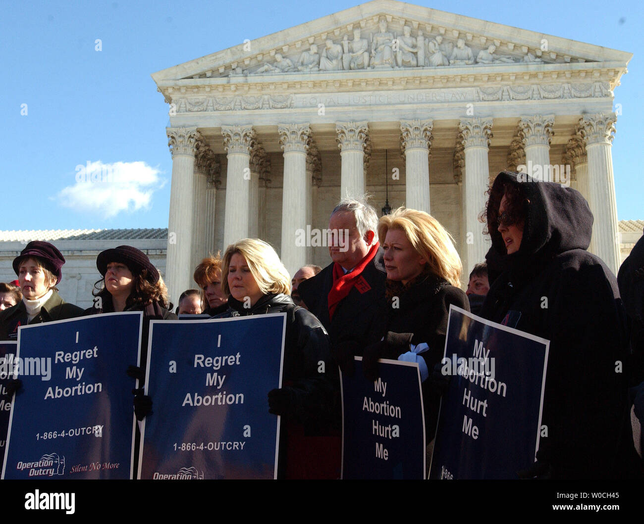 A group of women who have had abortions and regret them participate in a news conference in front of the Supreme Court, urging the court to vacate the Roe v. Wade decision and allow states to set abortion policy on Jan. 18, 2005, in Washington. (UPI Photo/Roger L. Wollenberg) Stock Photo