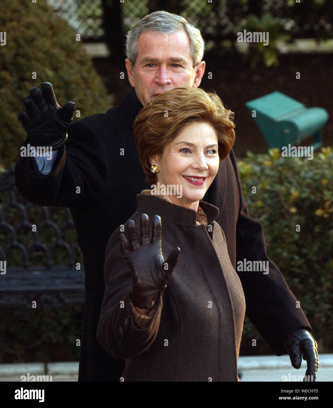 U.S. President George W. Bush and First Lady Laura Bush wave to the press as they prepare to embark on Marine One on the South Lawn of the White House on Feb. 20, 2005. Bush is en route to Brussels, Belgium, for meetings with world leaders.   (UPI Photo/Roger L. Wollenberg) Stock Photo