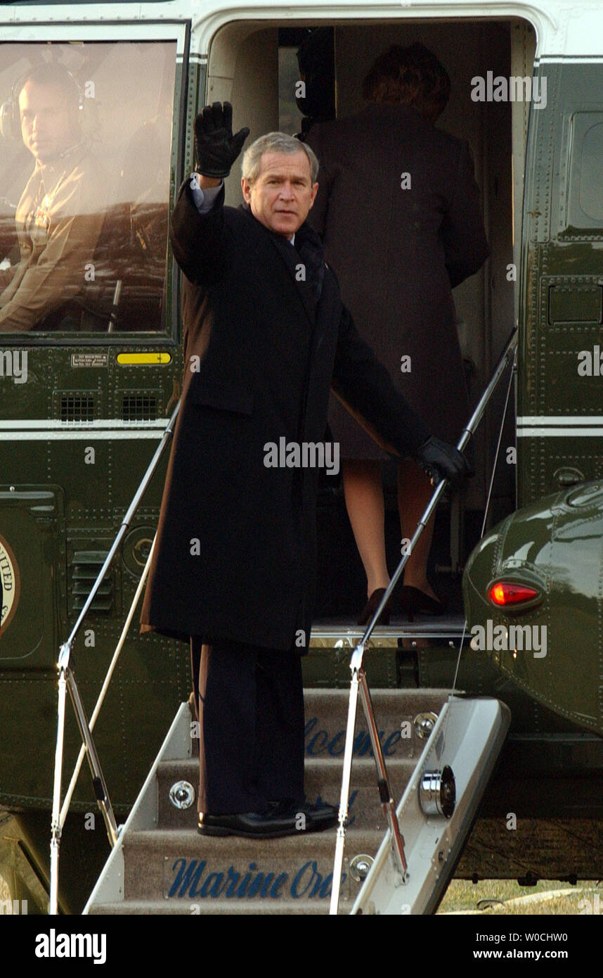 U.S. President George W. Bush waves to the press as he and First Lady Laura Bush embark on Marine One on the South Lawn of the White House on Feb. 20, 2005. Bush is en route to Brussels, Belgium, for meetings with world leaders.   (UPI Photo/Roger L. Wollenberg) - Stock Image