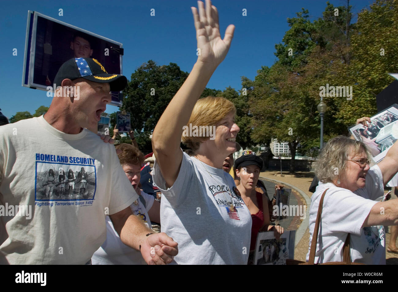 Anti-war activist Cindy Sheehan (C) waves to supporters with